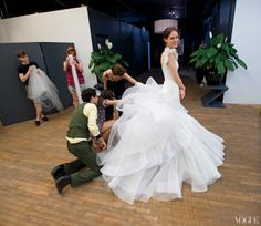 Coco Rocha married interior designer James Conran in a dress of organza, tulle, and silk crepe designed by Zac Posen, here supervising a fitting. The wedding was held in the 19th-century Château de Challain in France's Loire Valley in June 2010.    Photographed by Joshua Bright, Vogue, September 2010
