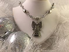A personal favorite from my Etsy shop https://www.etsy.com/listing/253470282/christmas-angel-necklace-silver-with