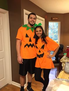 Pumpkin couple costume! Make the guy a collar for his leafs and a girl a bow! Me and my boyfriend! Such a cheap and awesome last minute costume #couplecostume #pumpkincostume #pumpkin
