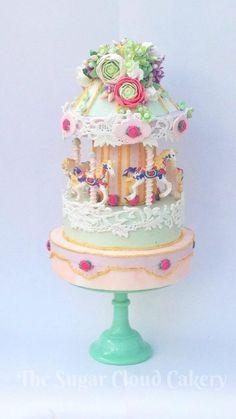 Floral cascade wedding carousel cake  ~ sugar cascade of flowers including ranunculus, hydrangea, roses and buds. all edible