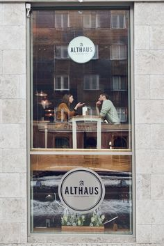 This is just a great reminder to 'use every square inch' when it comes to selling your brand. I don't mean this literally - but rather than having your logo in middle of the pane and blocking the view in (another opportunity to sell your venue) and out - place your logo in the bottom and top third which equals twice the sell.  Althaus Restaurant by P-B Studio and Filip Kozarski #restaurant #bavarian #poland #interior #travel #food