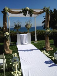 Imagine an arbor with white and crystal branches, lights and white floral
