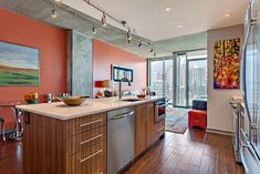 Another view of a contemporary kitchen designed by our Award-winning design staff, for a condominium. Nashville Skyline, Stainless Steel Kitchen Appliances, Kitchen Design Gallery, Contemporary Kitchen Design, Entertainment Center, Service Design, Home Office, Dining Room, Condominium