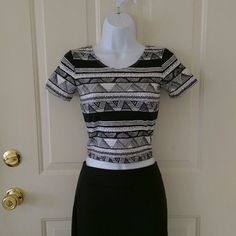 American Apparel Aztec pattern crop top Black and white short sleeve crop top with Aztec pattern from American Apparel.  This top is brand new, but it was bought online, so it does not have store tags. Size small. *Please note: There is a rip in the seam near the right shoulder, as pictured.  Easily repaired! :) American Apparel Tops Crop Tops