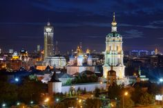 A colorful night time view of Moscow city, with Novospassky Monastery prominent. This stunning picturesque scene was shot in the Russian capital during 2012 Burial Vaults, The Miracle Worker, Best Jigsaw, The Transfiguration, Exposure Time, Night City, Empire State Building, Castle, Palaces