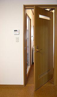 ローリングドアで通路のスペースを確保 リフォーム スライディング