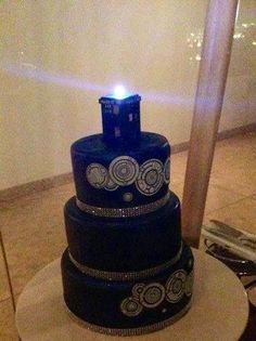 Doctor Who cake with a TARDIS on top. @Kailey Spence Spence Spence Harvey