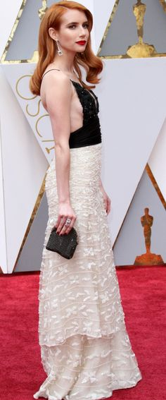 Emma Roberts oozed quiet sophistication in her vintage Armani Privé two-tone gown