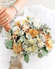 If these pretty petals appear too good to be true, take a closer look. Mother Nature provided the chrysanthemums, carnations, button mums, English daisies, and dusty miller. We added the faux finish by spritzing some blooms with gold and silver floral  paint, and dipping others into metallic glitter.