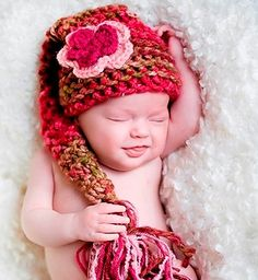 Gorgeous Baby Stocking Hat Shades of Rose & Green with Flower Clip. $24.00, via Etsy.