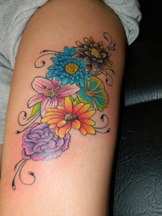 """This is what I'm thinking for my """"Family"""" tattoo. Birth month flowers for my mom, dad, brother, sister and myself. Then I'm thinking of adding small butterflies for my nieces, nephews and my own children in their birthstone colors."""