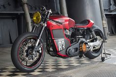 The Swiss team at Tricana  did a really great job, radically transforming a large and comfortable Harley FLH in a cafe racer slim and ...