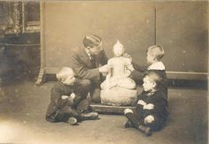 'Seeing' Buddha - Blind boys examining a Buddha at Sunderland Museum back in 1913. 'Tyne & Wear Archives & Museums'