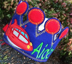 Appliqued Birthday Crown with Rocket from Little Einsteins! Age Appliqued in Black with Red stitching! Rocket in traditional colors with name embroidered in green!