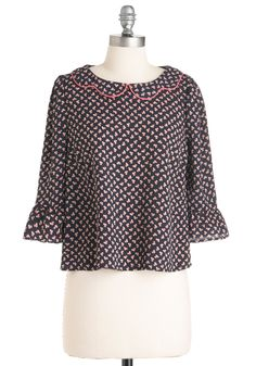scalloped collar with bright fuchsia trim, button-closed back keyhole, and belled half sleeves