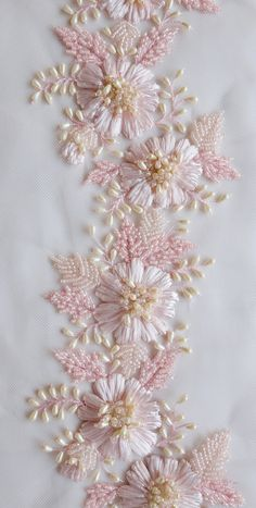 Hand-embroidered trim with pink raffia flowers and drop-shaped