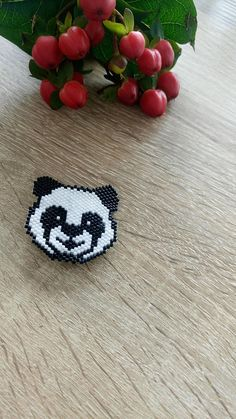Handmade brick stitch brooch, panda brooch, animal brooch, miyuki beads brooch, panda pin, seed bead pin, beaded brooch, birthday present This lovely panda brooch is made in brick stitch technique from Japanese miyuki delica seed beads and reverse side - from Japanese Toho beads.