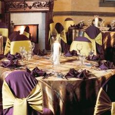 Eggplant LamourChair Cover and Napkin, Renaissance Sheer Table Top, and Citron Lamour Chair Ties for a warm party or wedding reception.