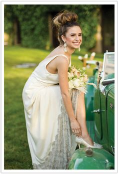 The bride looks effortlessly elegant in her beaded gown and exquisite earrings by BHLDN.  Design by Alchemy Fine Events, Photo by Mike Larson.