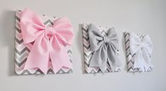 Large Gray, Light Pink, and White Bows on Gray and Pink Chevron Canvases 12 x12 Wall Hanging. Wall Decor ***Matching and Coordinating Pillows Available Please see Shop: http://www.etsy.com/shop/bedbuggs  ALL ITEMS ARE MADE TO ORDER PLEASE SEE SHOP FOR CURRENT CREATION TIME!!!  Stunning Touch to any wall and room! More Flower Designs and Colors Available, we can custom to your decor!  Bows are made from the Highest Quality Wool Felt. Bow measures about 10 wide and 10 Tall and it about 2…