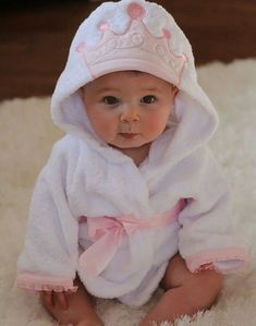 Baby girl in pink crown robe