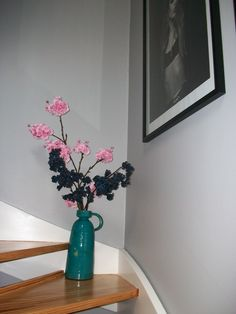 Abigail ahern cherry blossom vase flower, Chic SHADOW GREY dulux  paint on walls hallway staircase. The Chci Shadow colour is a mid-grey, appearing lighter in very bright sunlight, but mid in normal/shadow. I find it is a clean grey, not too bleuey nor browny nor lavender. We used Endurance matt for hallway.