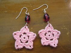 crocheted earrings, pink flower with a purple bead on Etsy, £5.35