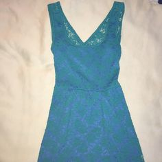 Teal green and blue lacy dress Teal green lace layered on top of a blue slip creates the perfect color combination for this dress! Soft, comfortable, and elastic around the midsection. The back has an open slit to show off some skin! Perfect for a formal occasion or the spring/summer time! Only been worn twice by me! LIKE NEW! Francesca's Collections Dresses