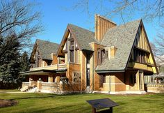 Nathan G. Moore House, Oak Park, Illinois, 1895; rebuilt 1923  Frank Lloyd Wright always hated the house that Nathan G. Moore asked him to design, with its faux-Tudor style (bottom). It was one of FLW's earliest commissions, and he freely admitted that he did it only for the cash. Years later, when the top two floors of the house burned in a fire, Wright seized the chance to imbue his original design with new Mayan-Japanese flavor.
