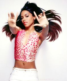 This was Aaliyah- wearing a pink cheetah print shirt referring to beta mind control programming.