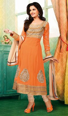 Bollywood Diva Monica Bedi Georgette Long Anarkali Suit Attain a charming look just as Bollywood diva Monica Bedi wearing this deep orange georgette long Anarkali suit. The ethnic patch, resham and stones work in the dress adds a sign of elegance statement to your look.  #GeorgetteLongAnarkaliSuit #EmbroideredAnarkaliSuit
