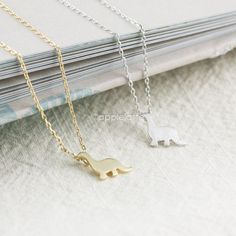 tiny dinosaur necklace in gold or silver by applelatte on Etsy, $11.80