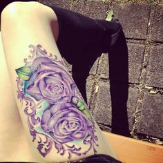 Thigh tattoo. Love the colors