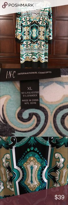 INC V-Neck Dress INC Black, Teal, Gold and White V-Neck Shift Dress with 3/4 elastic sleeve.  Sequins on front.    35 1/4 inches from Shoulder to Hem.  Above the Knee, but not a mini.  Bust measures 40 1/2 inches.  Price Firm!  Excellent condition! INC International Concepts Dresses