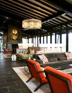 brights in a neutral room - Nyungwe Forest Lodge by Keith Design  M2K Architecture