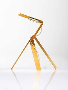 Ingo Maurer, lighting design at its best, Jetzt 2 is a sculptural lamp, with a laser cut frame. The body is made from twisting a rectangular-shaped metal sheet. Jetzt 2 is part of the permanent design collection at MoMa, New York.  
