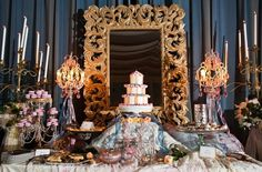 A large and ornate gold mirror makes a great focal point for a ...