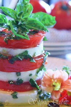 CAPRESE TOWERS~ SUMMER ON A PLATE _ Drizzle a little balsamic vinegar around the edge of the plate. Save a few pretty tops of a basil plant for garnish. Savor with a crusty piece of bread to mop up every last drop of summer infused oil!