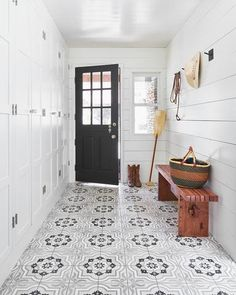 Cute and cozy mudroom designed with white, gray and black quatrefoil floor tiles and white shiplap walls. White Shiplap Wall, White Walls, Built In Lockers, Black Doors, Ship Lap Walls, White Space, Tile Floor, House Design, Floor Design