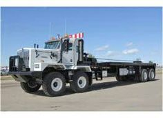 Camex oilfield bed trucks are built to take on the toughest payloads on extreme terrain - used primarily to load, move and stage heavy rig components. Heavy Duty Trucks, Heavy Truck, Heavy Construction Equipment, Heavy Equipment, Semi Trucks, Big Trucks, Tow Truck, Oil Heater, Oilfield Man