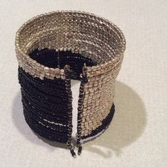 """Black and Silver Cuff Bracelet NEW, NEVER WORN.  Very cool silver and black graduated beaded cuff. Width - 2"""" Jewelry Bracelets"""