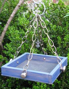 Fade to Blue Wood Bird Feeder Tray with Guardian by gardenfinds. easy to replicate! Wood Bird Feeder, Bird Feeder Craft, Bird House Feeder, Homemade Bird Houses, Homemade Bird Feeders, Ladybug House, Pallet Crates, Garden Animals, Blue Wood