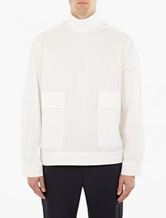 Acne Studios | White Cotton Solar Shirt | Acne Studios continue to pave the way in the field of contemporary design, with this unique 'Solar' shirt a stand-out style from their AW16 collection. Crafted from crisp cotton with a crumpled texture throughout, the shirt is finished with a mock-neck snap-fasten collar, large patch pockets to the hips and adjustable Velcro cuffs.