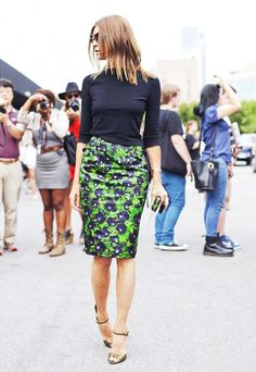 I love this look...peacock looking pencil skirt with a black blouse