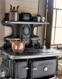Old woodstove turned electric. Would love to have this in the corner of a kitchen, just for baking bread, pies, etc... Just might make me want to start baking again :)