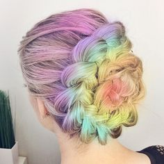 Purple yellow rainbow braided bun dyed hair color