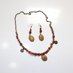 "Carnelian Elegant Jewelry Set -Handmade Jewelry Set from ""Unique handcrafted jewelry from Arijeta "". This Jewelry Set has small stones from carnelian and sun gold beads. Between these colored stones, has copper parts.  Material: They are made of Carnelian, sun gold beads and copper"