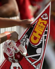 Fans hold their Chiefs gear in hopes of getting autographs after Kansas City Chiefs' NFL football training camp. #NFLFanStyle and #contest