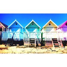 Beautiful pastel beach huts