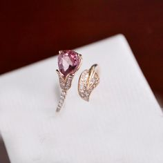 1 Carat Pink Tourmaline Ring With Diamonds In 14K Rose Gold (Etsy -- $599)...not my color...but cool design...